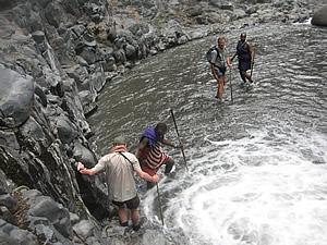 People exploring stream at Lake Natron